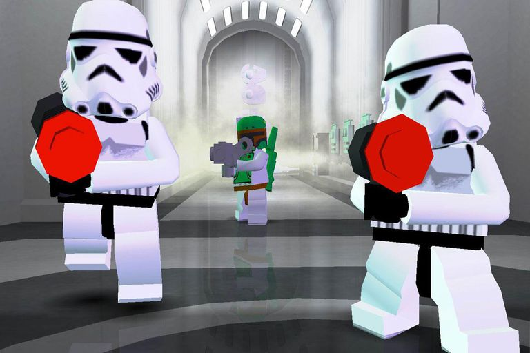 Two stormtroopers and Boba Fett from LEGO Star Wars II