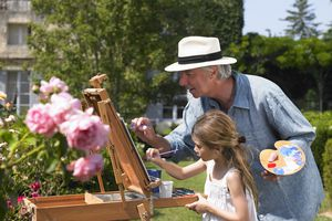 French grandfather spends time with granddaughter