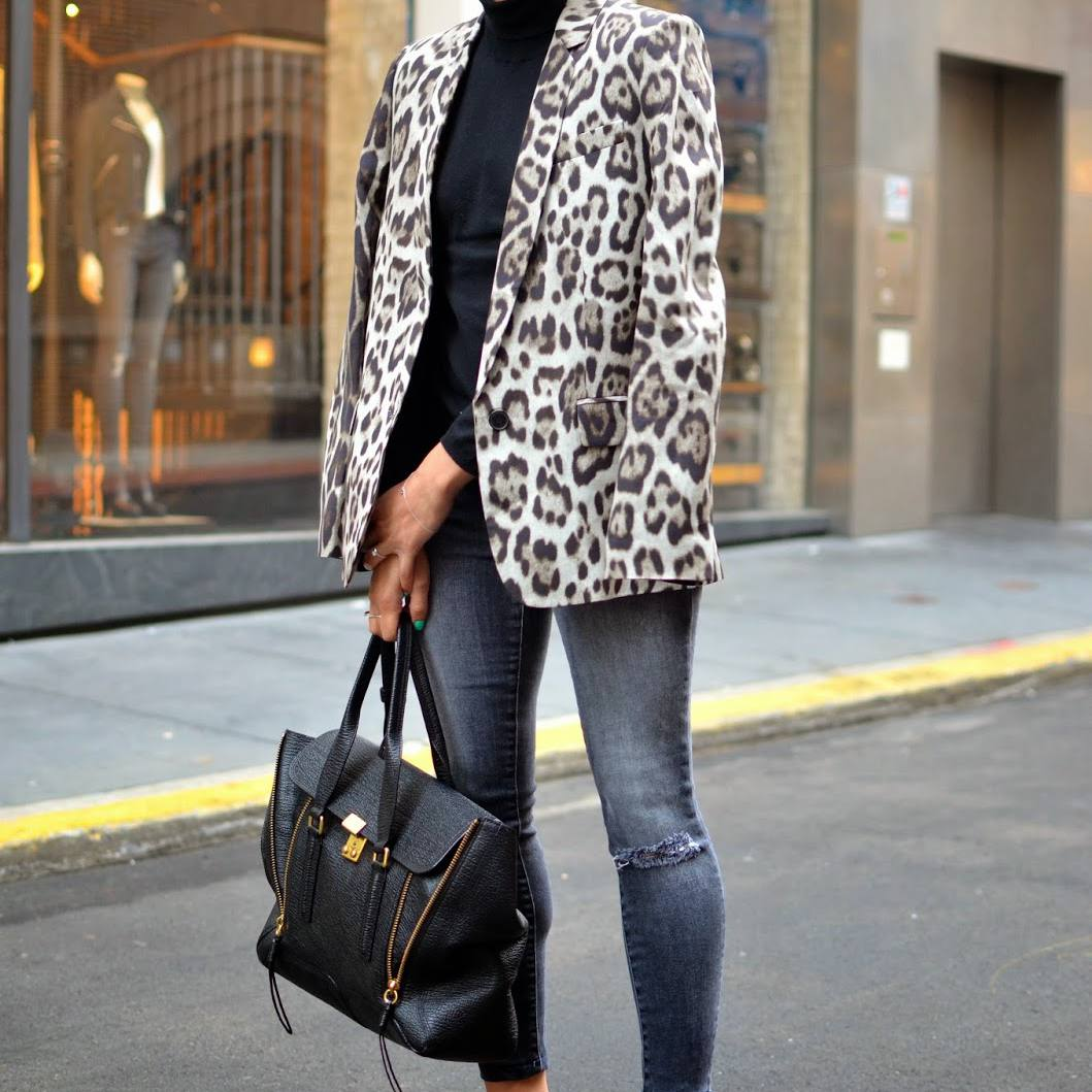 Woman in leopard print jacket and jeans