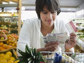 Woman Shopping With Coupons