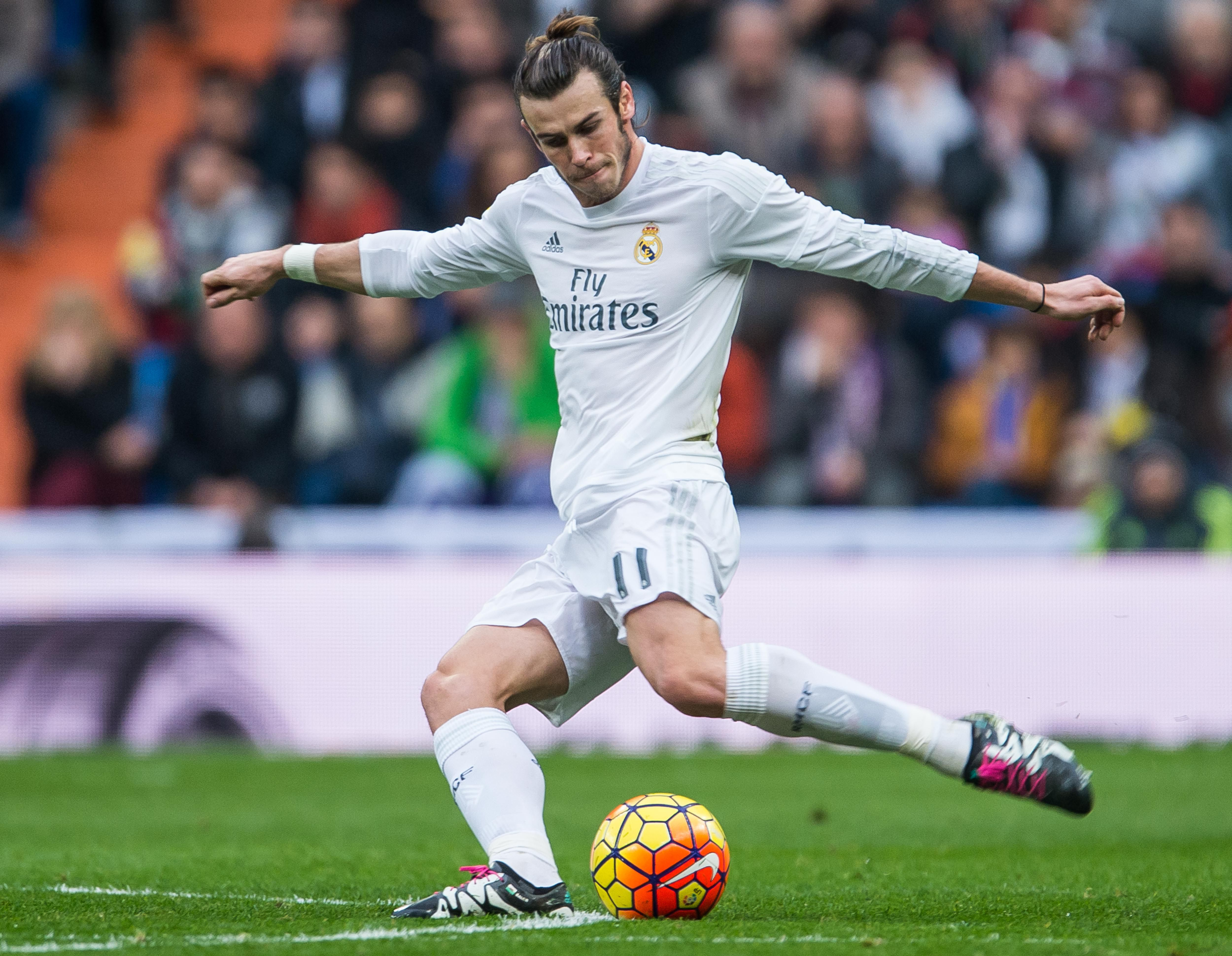 Gareth Bale kicking a soccer ball