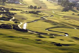 An aerial view of a link golf course during the daytime.