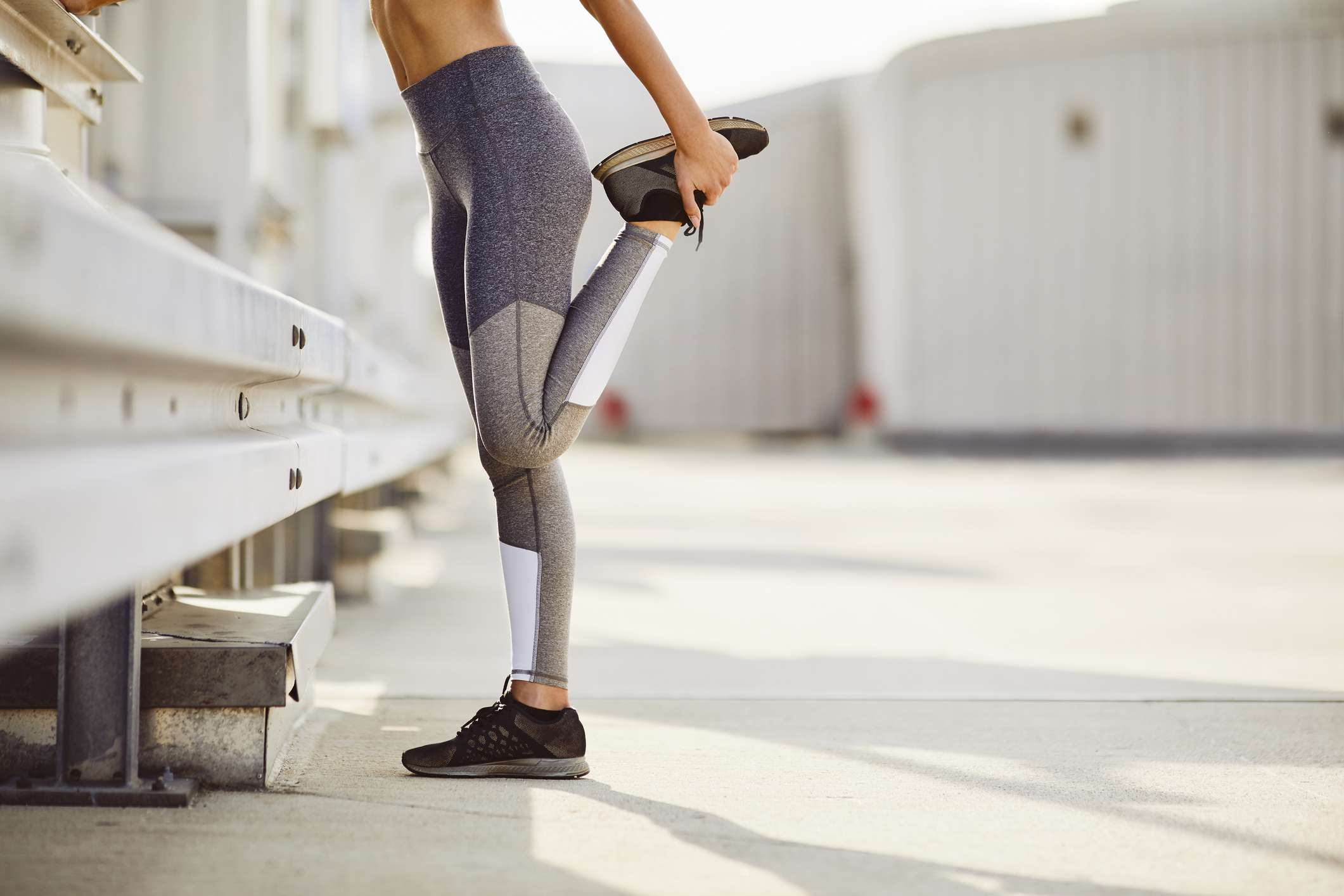 lower half of woman stretching