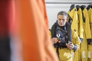 Offshore oil worker checking survival training equipment in pool facility