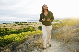 Black woman standing on rural hillside
