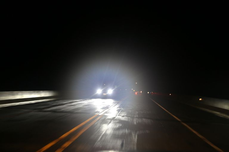 oncoming car with headlights on
