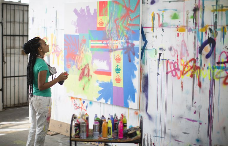 Young female artist working in her studio