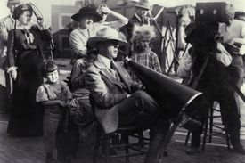Filmmaker D.W. Griffith directing a film circa 1918