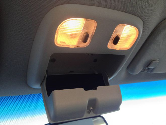 sunglass holder in car that looks like a face