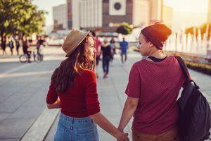 lesbian teen couple holding hands