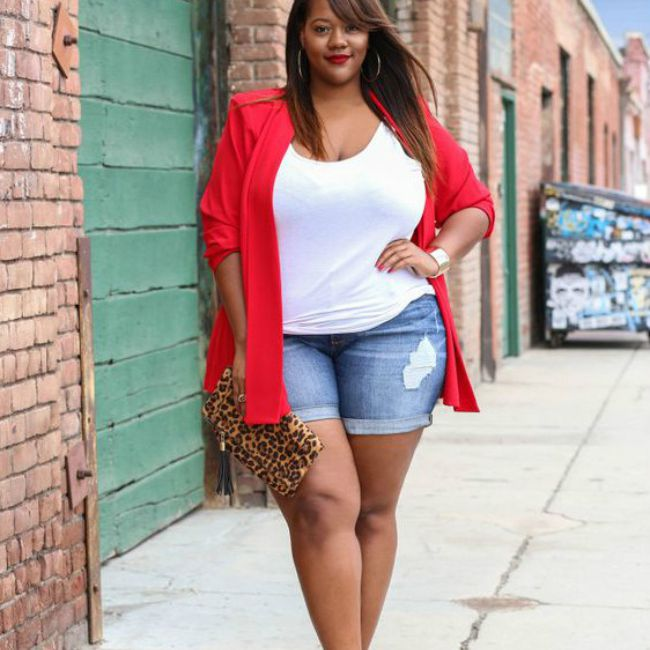 736a67de39f Woman in summer outfit of jean shorts and red blazer. Trendy Curvy