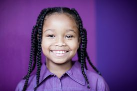 Girl with braids for stretching curls