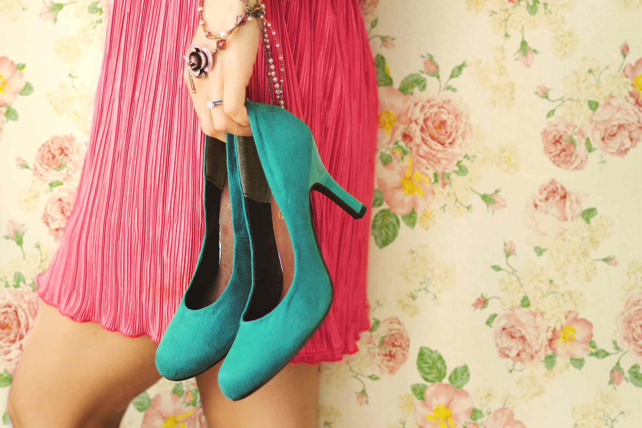 Woman holding blue heels