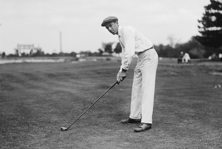 Photo of American golfer, Francis Ouimet, (1893-1967), posing in a driving stance.