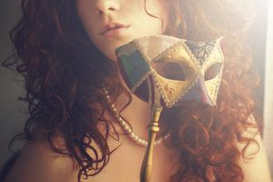 Young woman with venetian mask