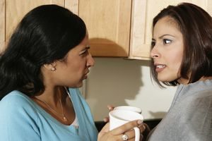 Side profile of two young women arguing