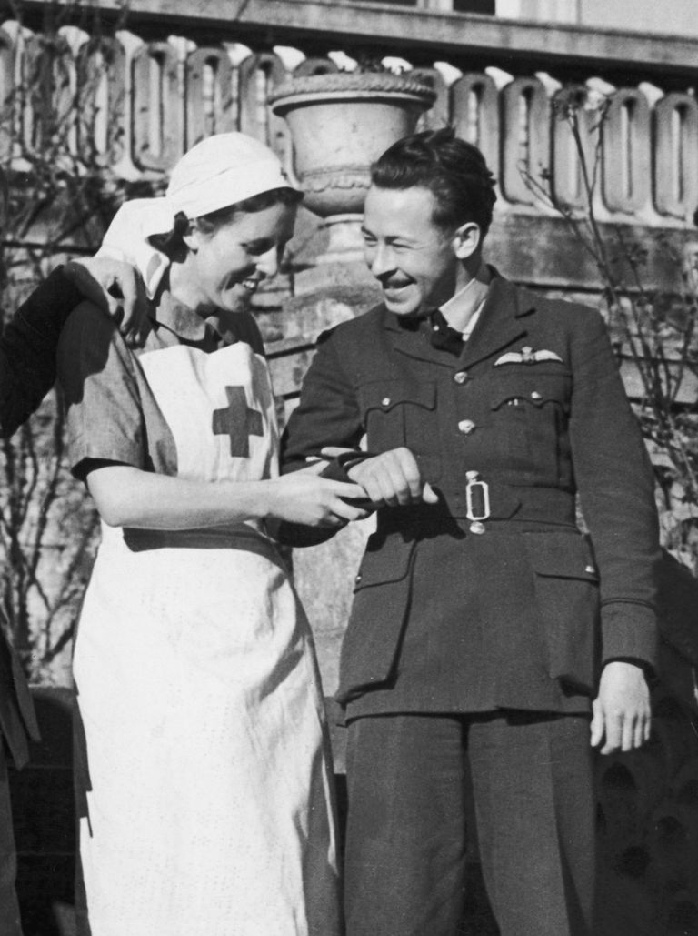 A nurse arm-in-arm with a serviceman