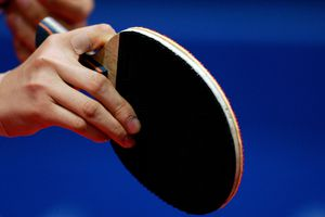 Holding a Ping Pong Paddle