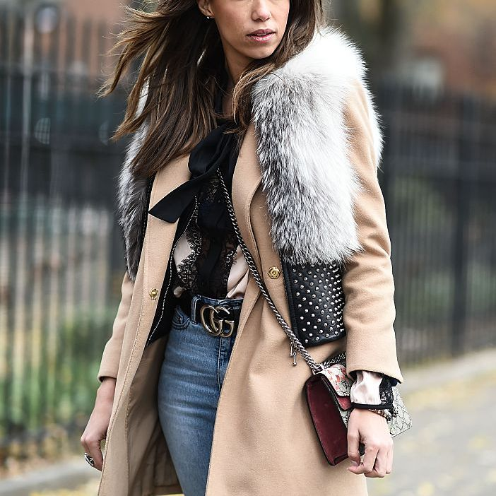 Street style fur vest and jeans