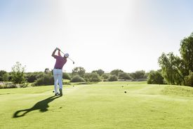 Many in full swing of golf club, teeing off
