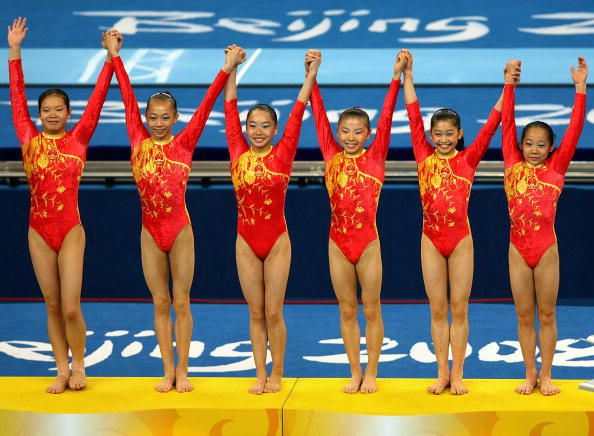 The Chinese gymnastics team receive their gold medals for winning the 2008 Olympic team title in gymnastics