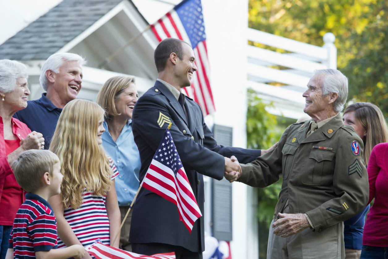A family greeting veterans.