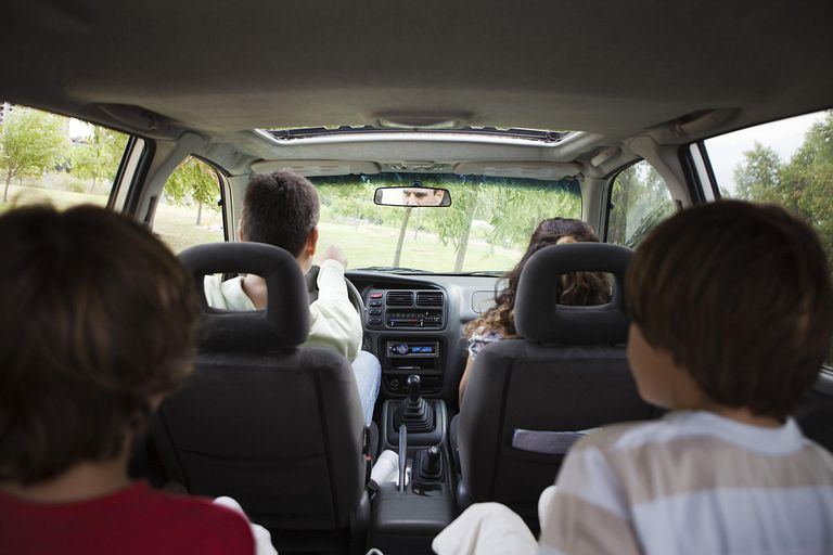 A picture of a family riding in a minivan