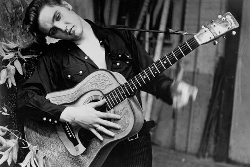Elvis Presley portrait with an acoustic guitar