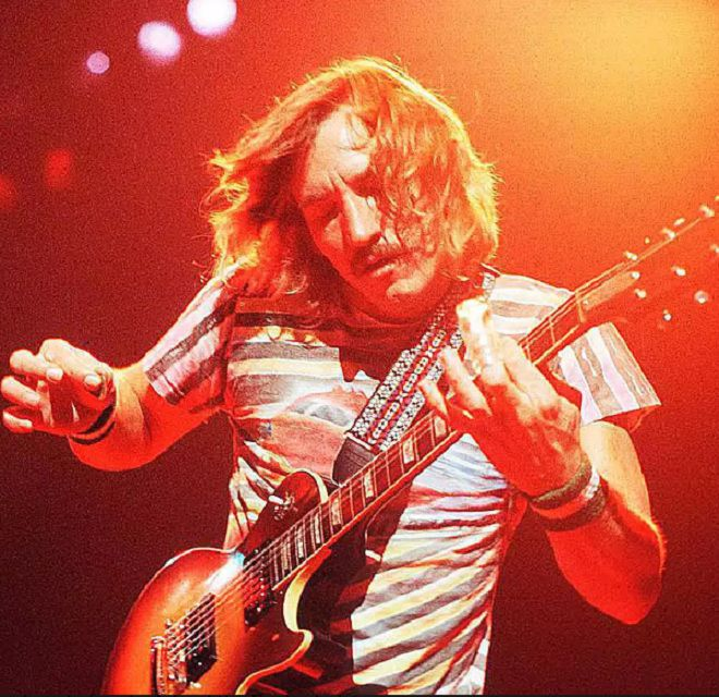 Joe Walsh of the Eagles performs live on stage with guitar.