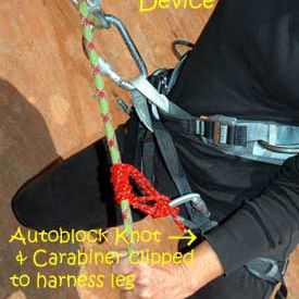 Use either your guide hand or brake hand on the autoblock knot.
