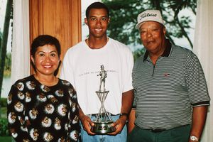 Tiger Woods with his parents Kultida and Earl Woods at the Johnnie Walker Classic at Blue Canyon Golf Club, Thailand in 1998