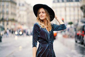 Woman wearing a wide brim hat and polka dot dress