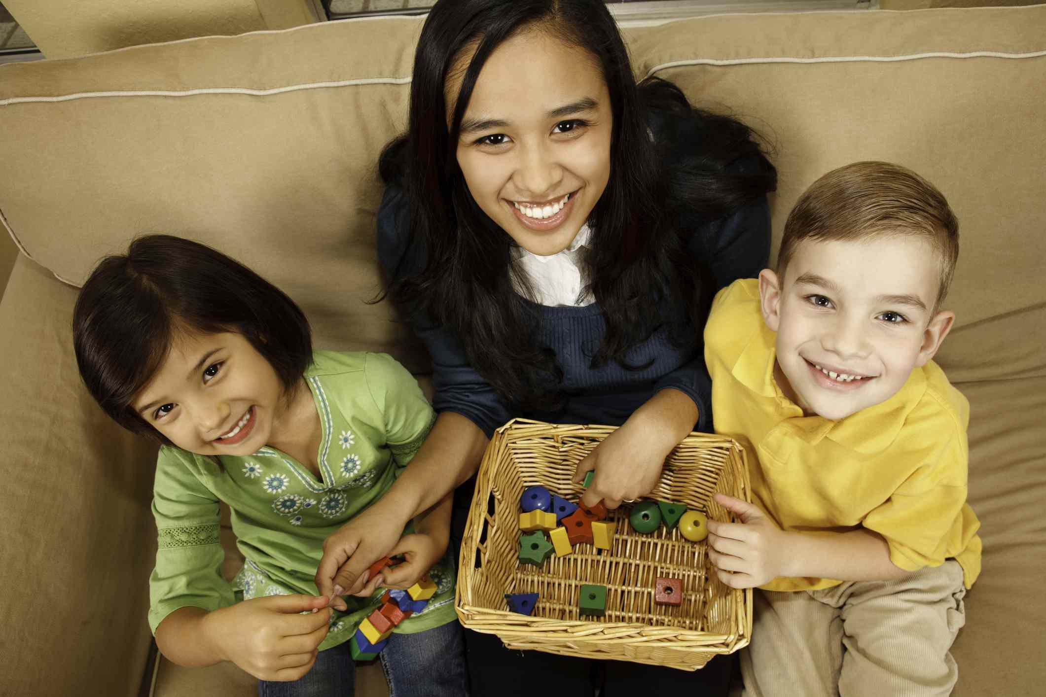 Babysitter with Two Happy Children