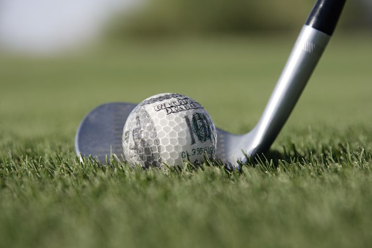 A golf ball made of money