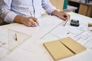 Architect working on construction drawing.