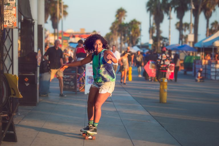 Venice Beach woman skateboarding