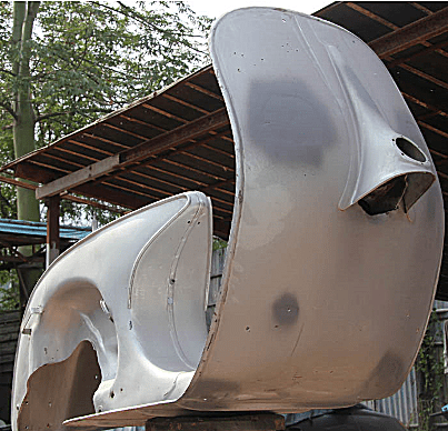After grit blasting, the chassis has been repaired as required and painted in primer.