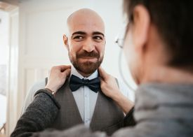 A straight or gay man wearing a bowtie.