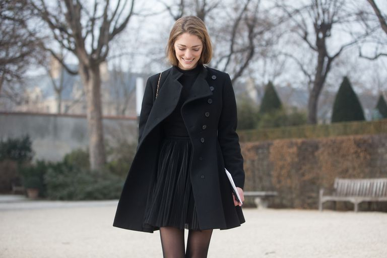 Street style woman in black dress outfit and black coat