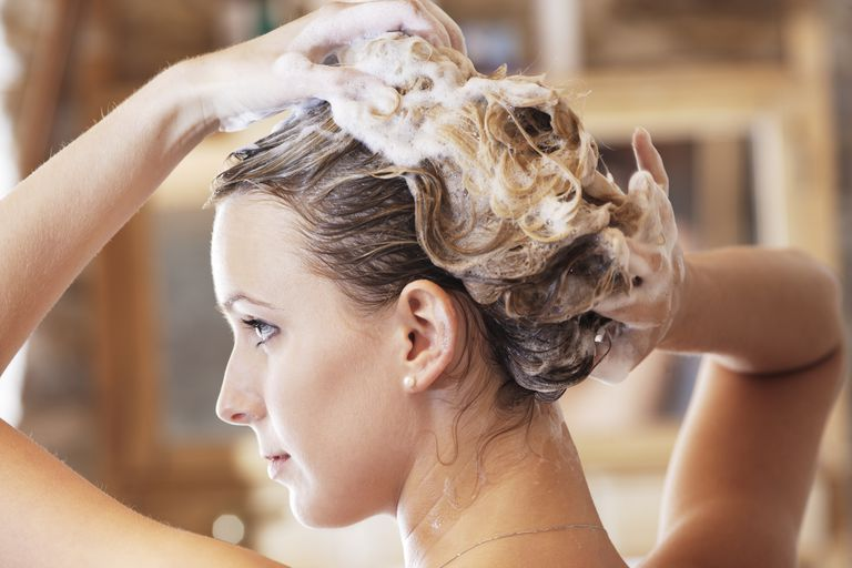 Young woman washing hair, close-up