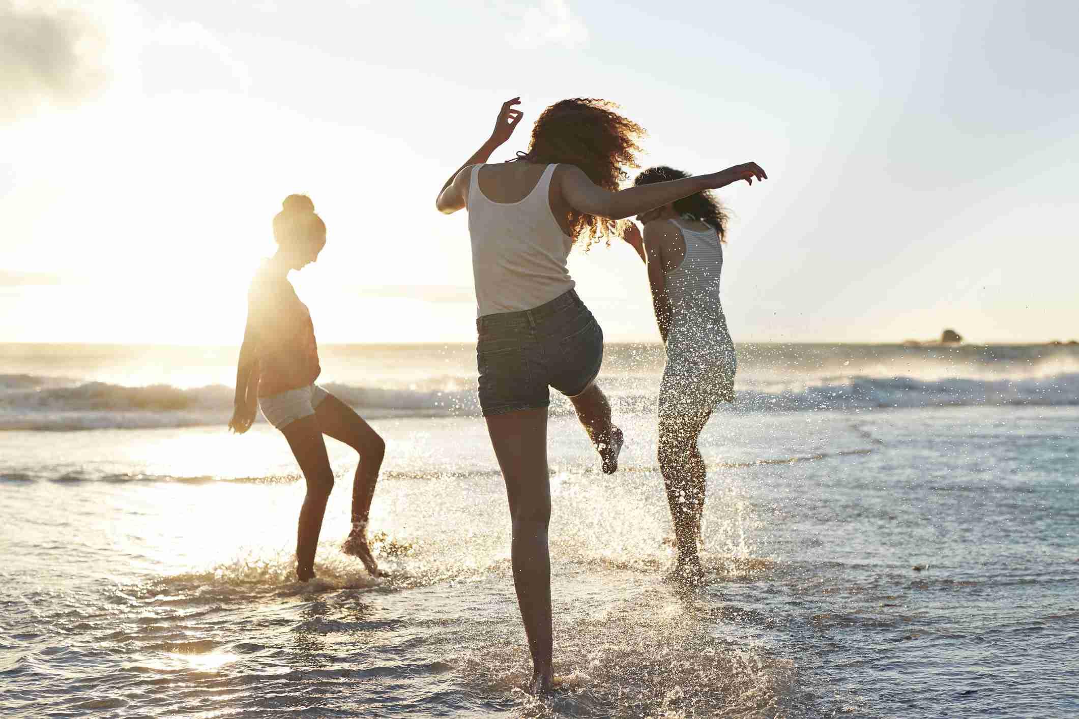 Three woman on the beach having fun
