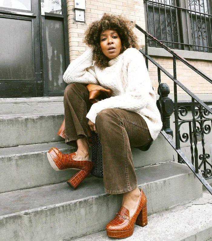 Woman on a stoop wearing platform heels