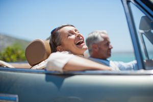Mature couple driving in convertible
