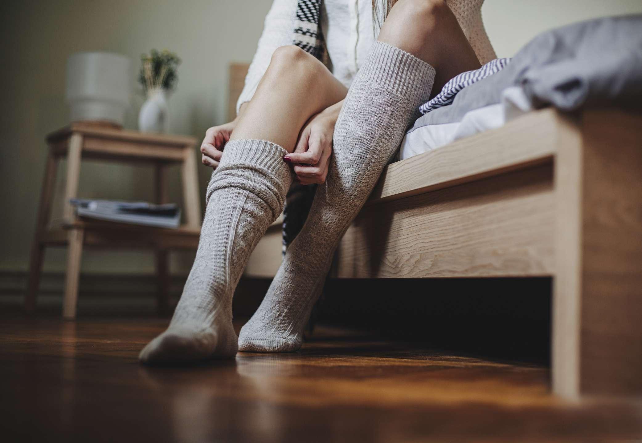 Woman pulling on socks