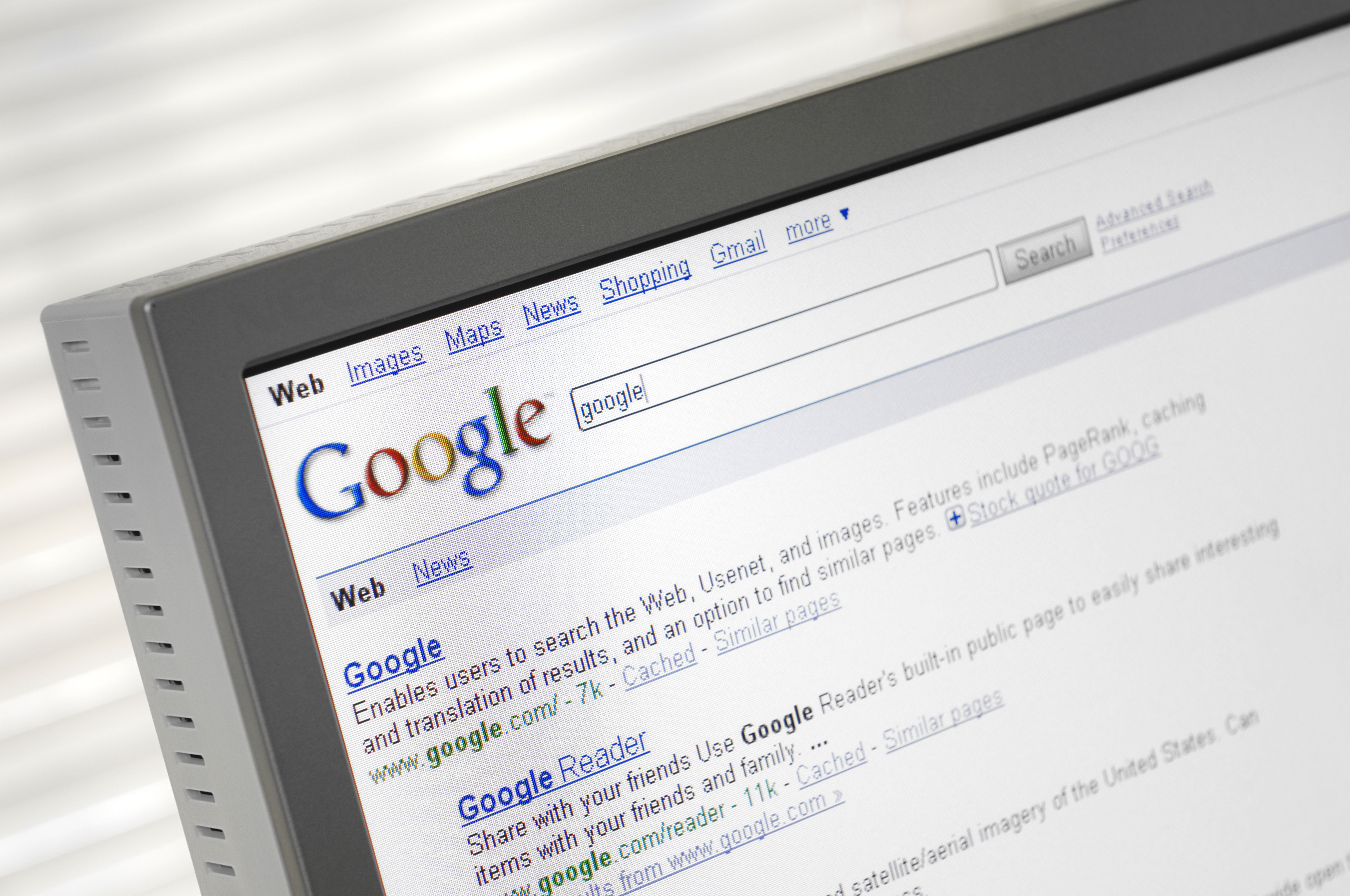 Google search engine page with search results displayed on a computer monitor.