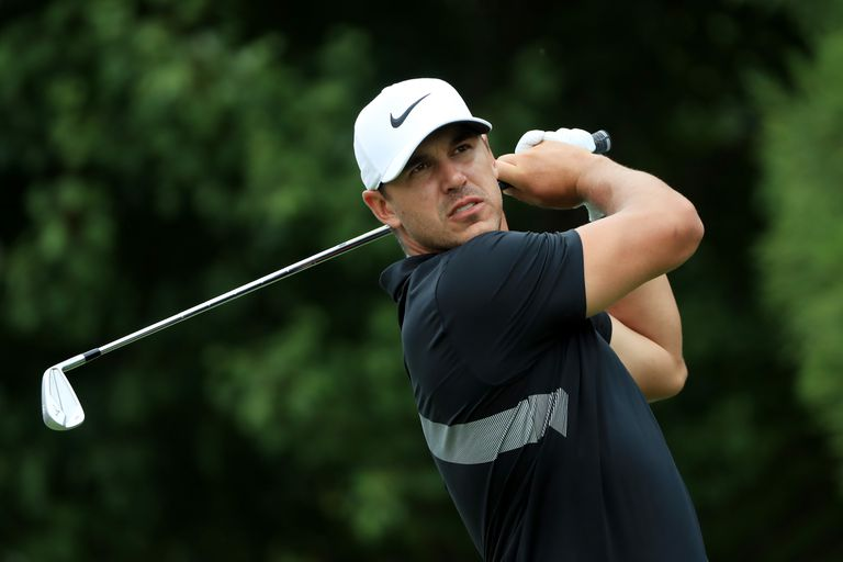 Brooks Koepka plays an iron shot during the 2019 Tour Championship.
