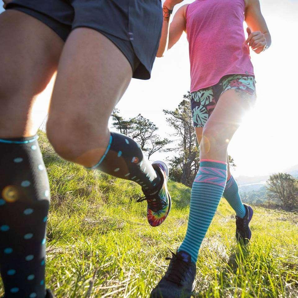Two women running through a field