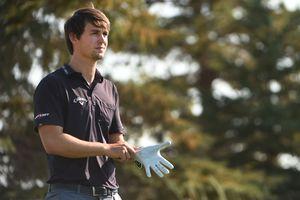 Ollie Schniederjans puts on his glove at the 2016 Utah Championship