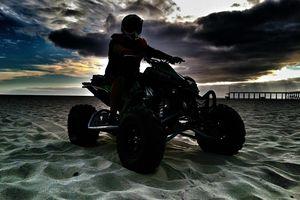 Silhouette Of Man On Quad Bike