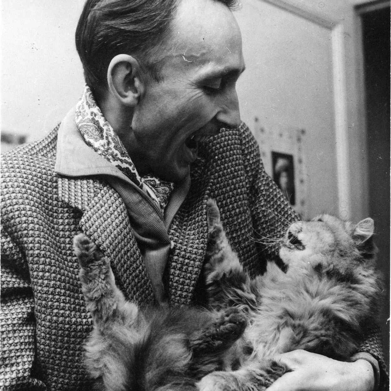 Portrait of Andre Bazin with cat
